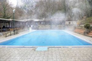When water evaporates from the pool, it changes from a liquid state into a gas that travels back into the atmosphere.